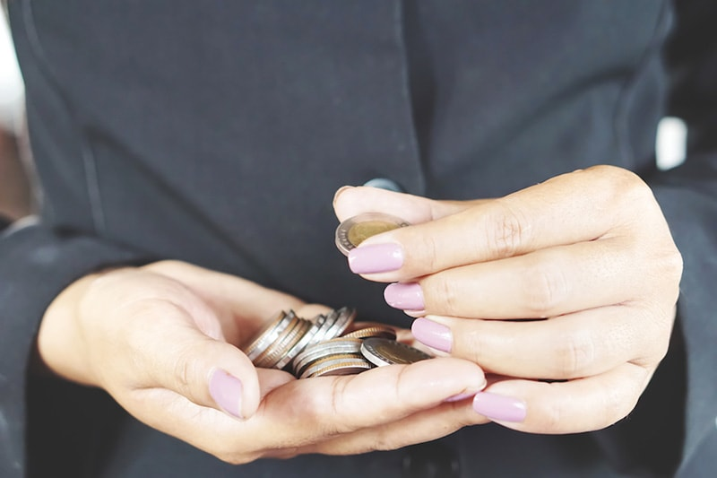 hands holding coins