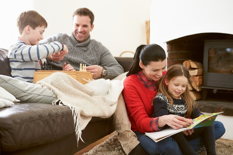 Happy family warm indoors, Fall Furnace Maintenance | Heating, Air Filters, IAQ | Hudson, MA | Chaves